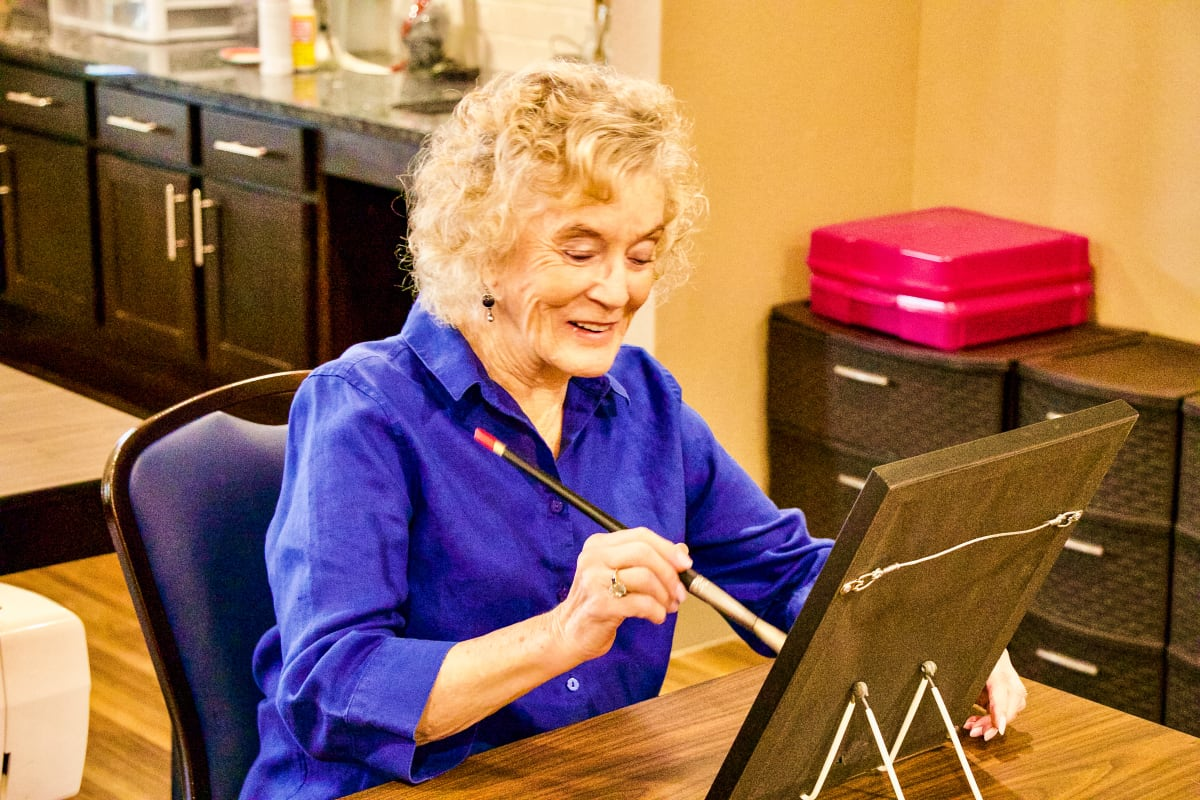 Resident painting at an Integrated Senior Lifestyles community