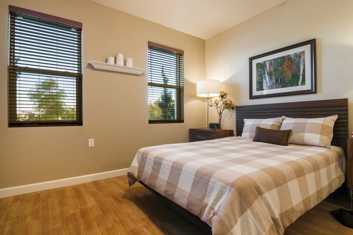 Resident bedroom with natural light at CERTUS Premier Memory Care Living in Orlando, Florida.