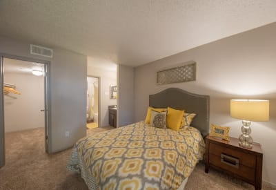 Well lit model bedroom at Trails of Towne Lake in Irving, Texas