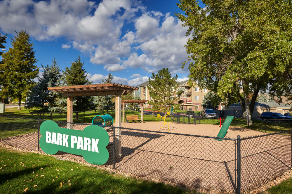 Have fun with your furry friend in the dog park at Promenade at Hunter's Glen Apartments in Thornton, Colorado