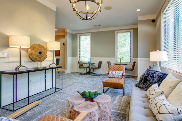 Well-decorated and spacious living area in an open-concept model home at Landing Square in Atlanta, Georgia