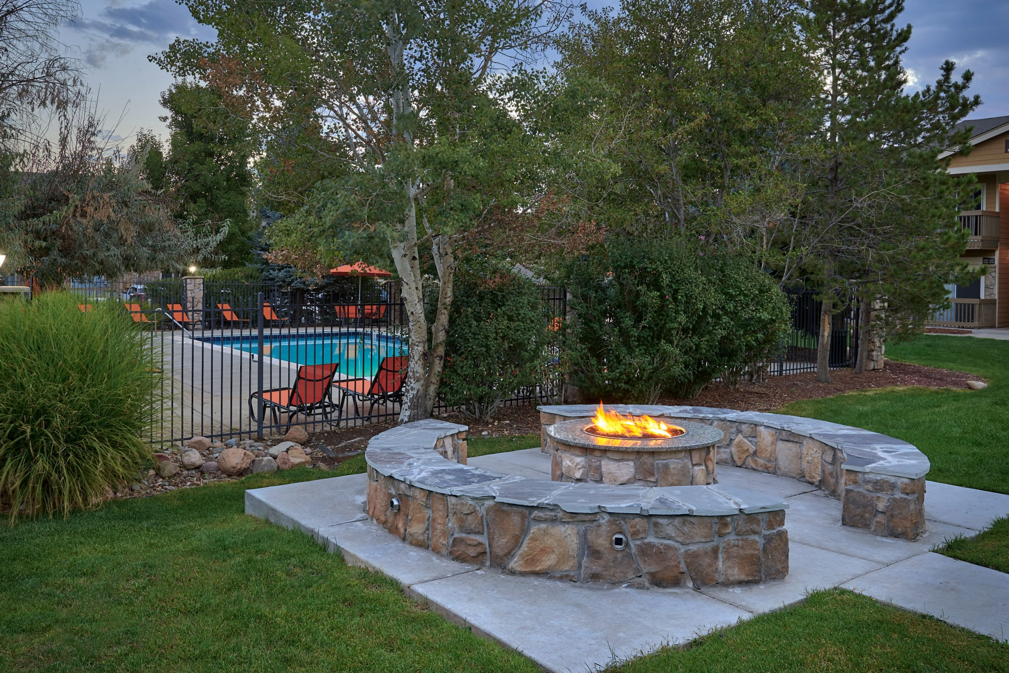The fire pit lounge area at Crossroads at City Center Apartments in Aurora, Colorado