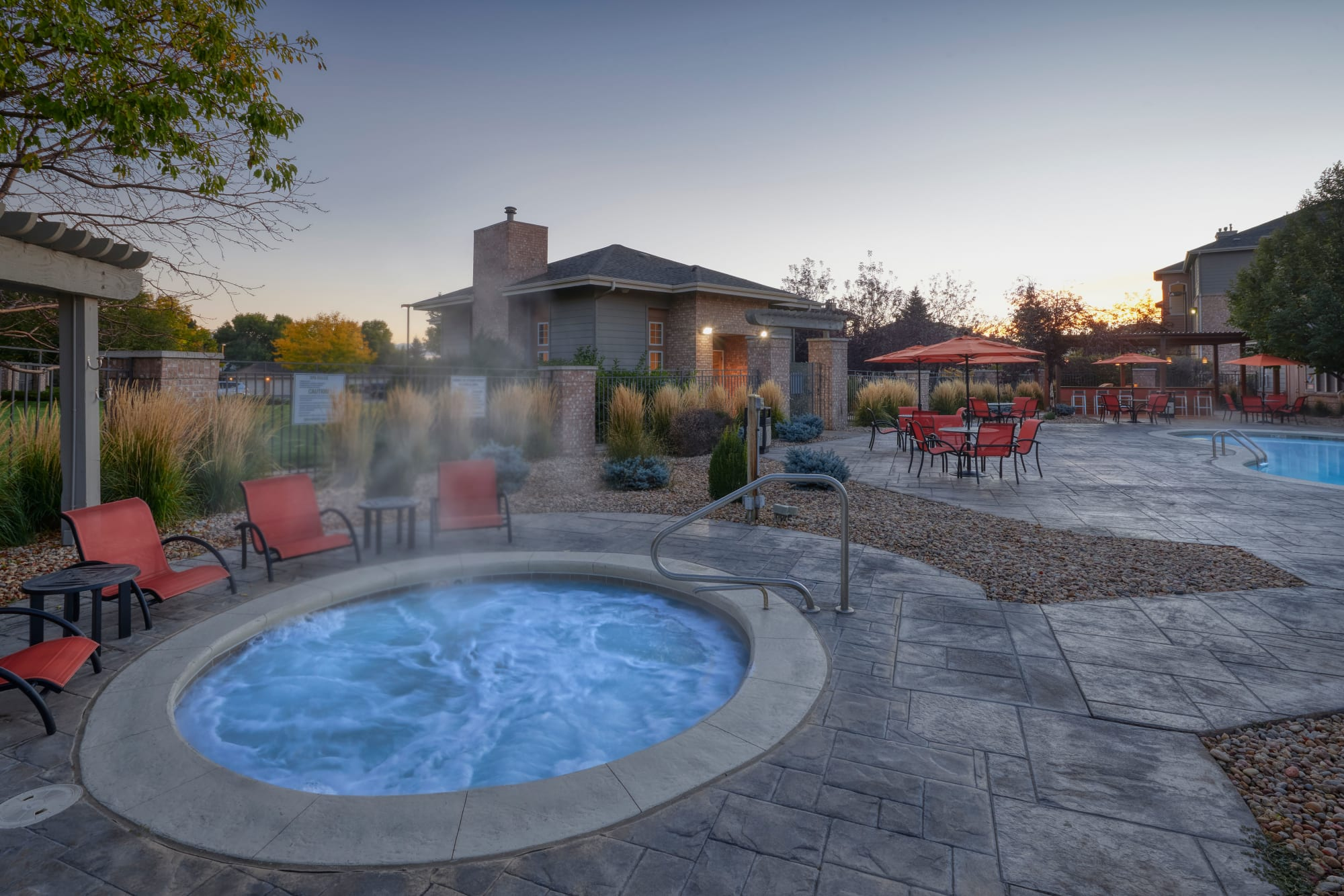 The relaxing hot tub and swimming pool at Hawthorne Hill Apartments in Thornton, Colorado