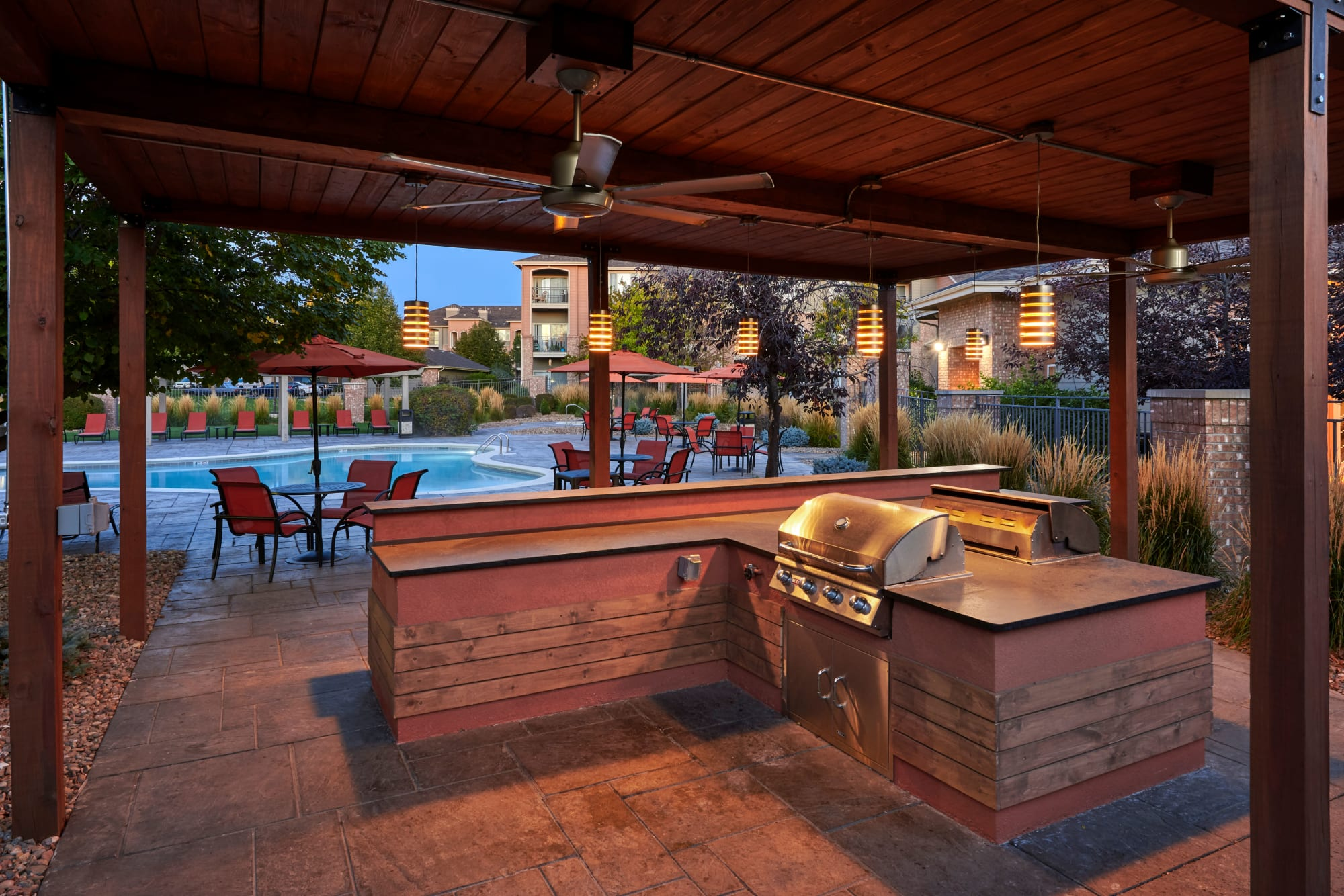 The poolside BBQ, perfect for entertaining friends, at Hawthorne Hill Apartments in Thornton, Colorado