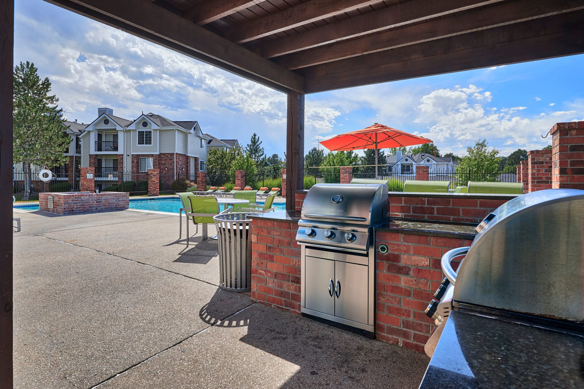Covered BBQ area Poolside by Villas at Homestead Apartments's pool