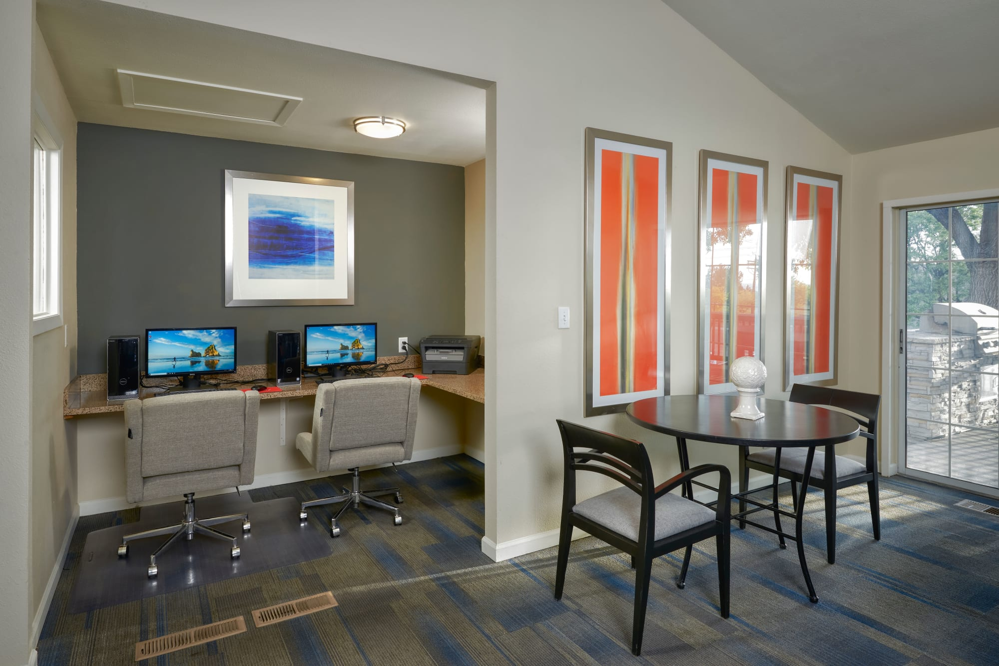 The business center in the clubhouse with computers for resident use at Bluesky Landing Apartments in Lakewood, Colorado