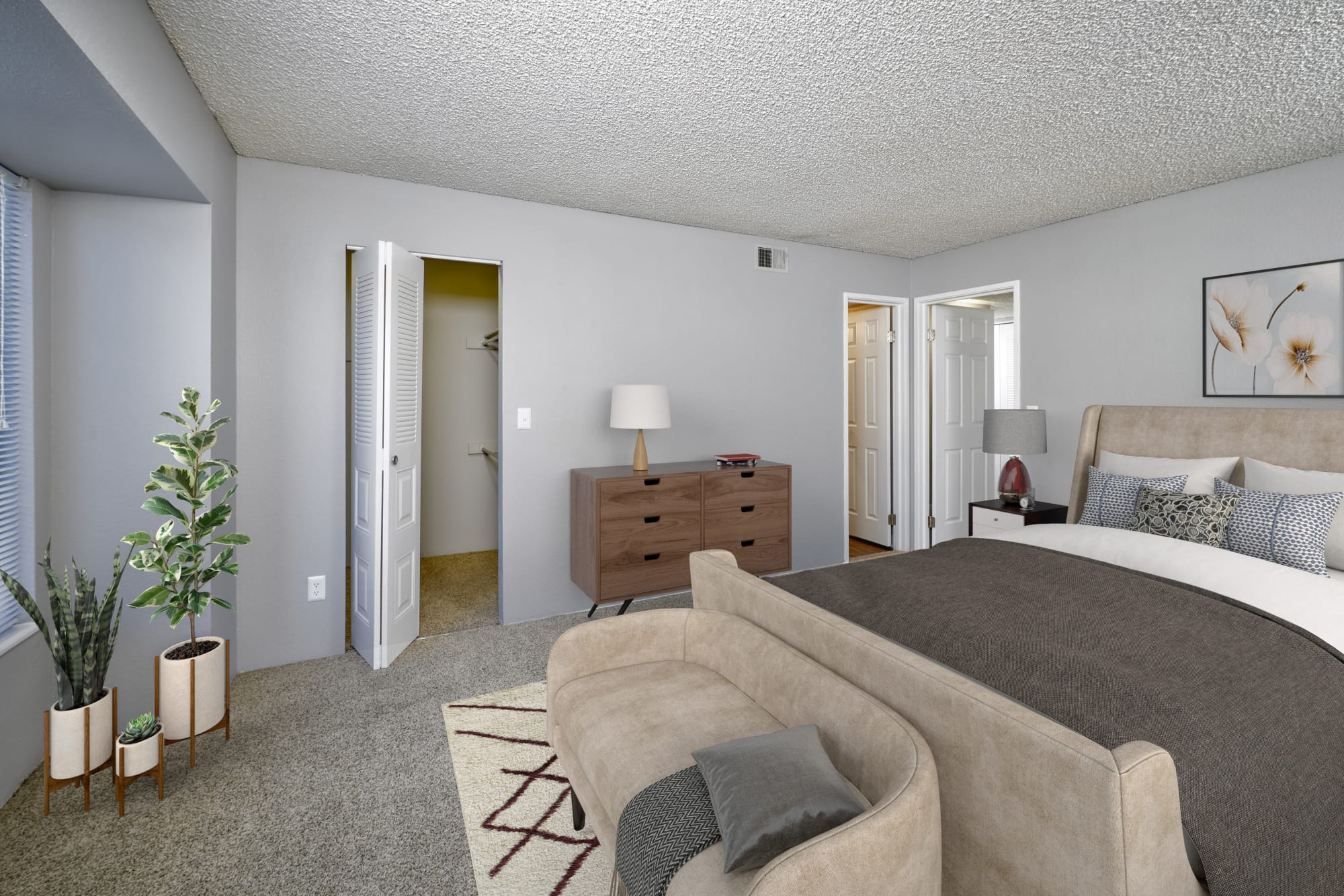 Spacious master bedroom at Alton Green Apartments in Denver, Colorado