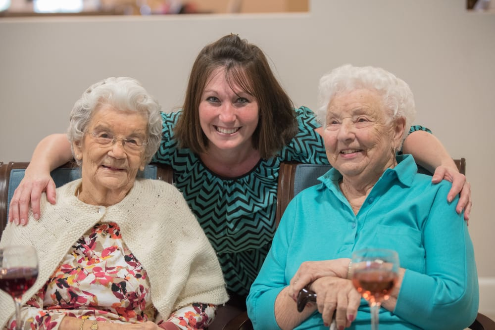 Residents and a staff member pose for a picture at Inspired Living Hidden Lakes in Bradenton, Florida