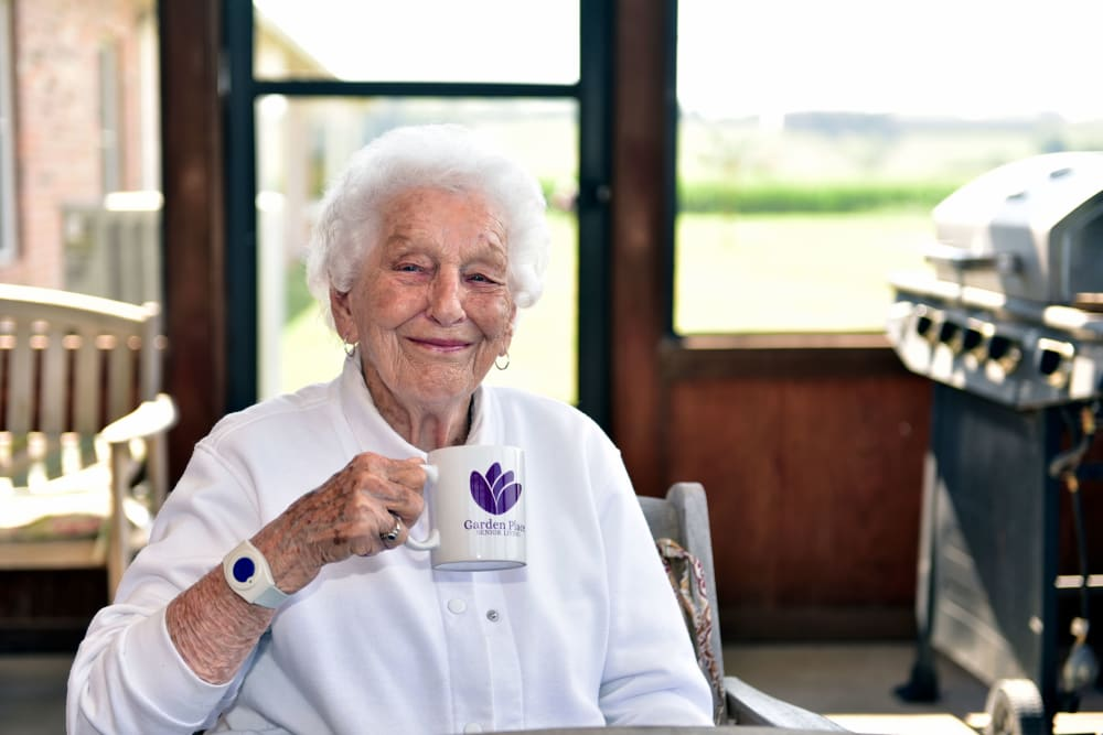 Resident drinking coffee at Garden Place Columbia in Columbia, Illinois.