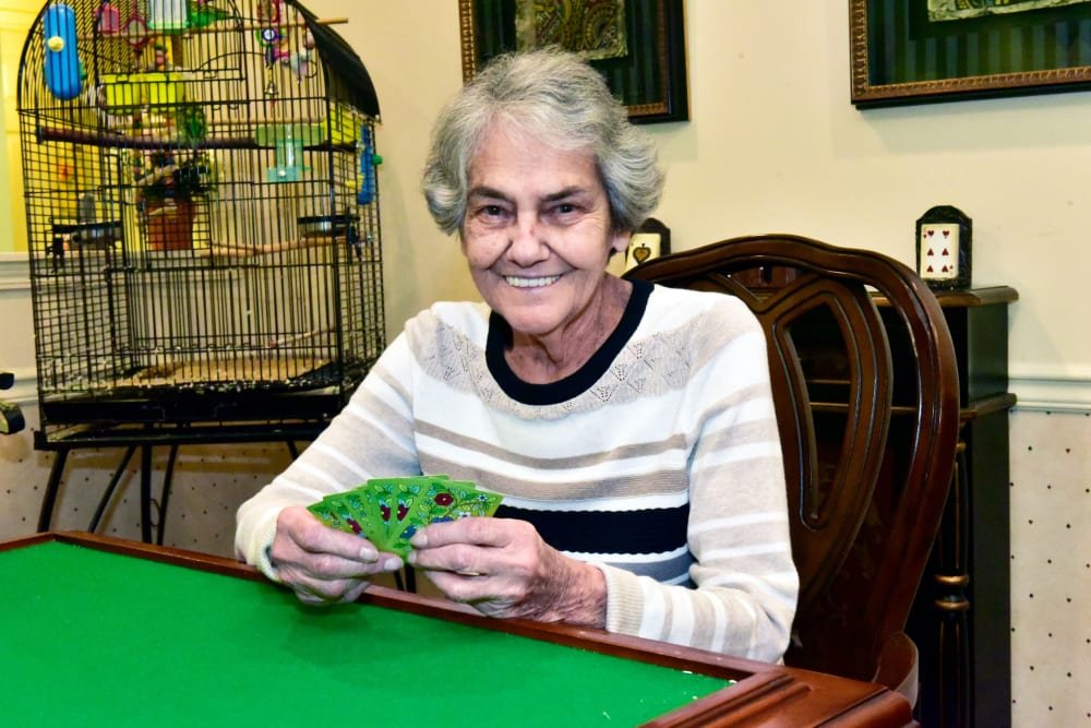 Resident playing cards at Garden Place Columbia in Columbia, Illinois.