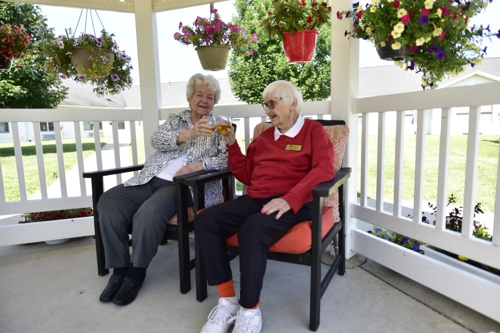 Two residents having a drink on the gazebo at Garden Place Columbia in Columbia, Illinois.