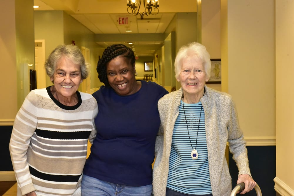 Residents pose for a picture with a staff member at Garden Place Columbia in Columbia, Illinois.
