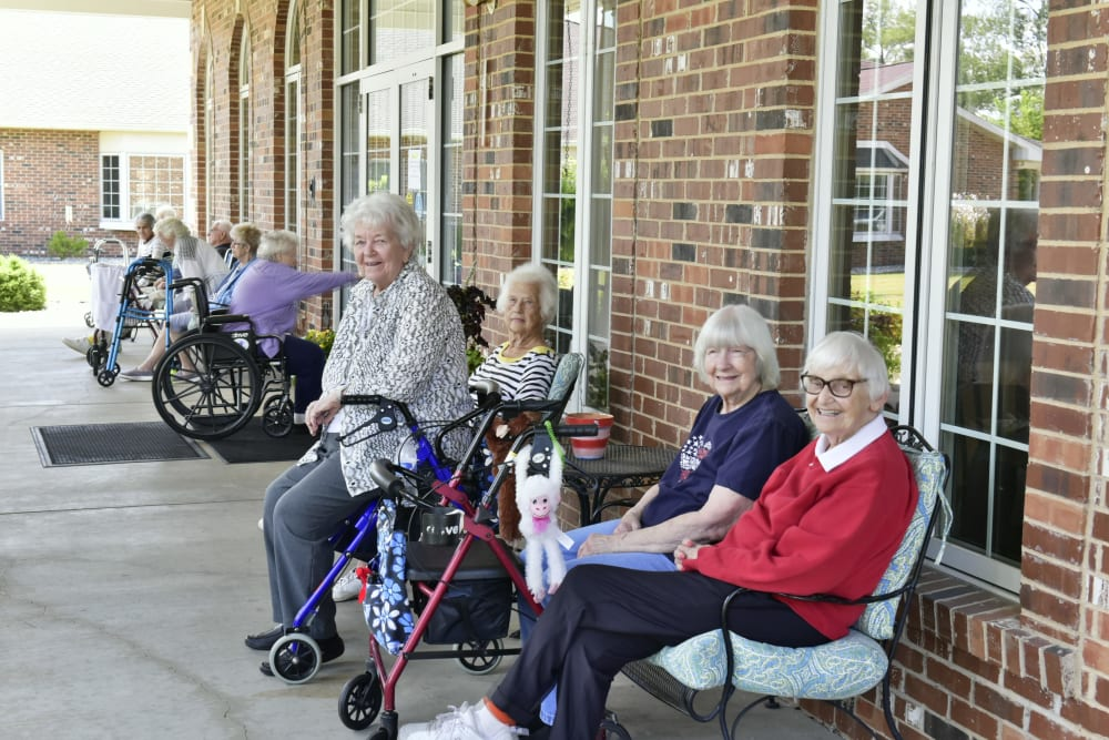 Residents sitting and enjoying the outdoors at Garden Place Columbia in Columbia, Illinois.