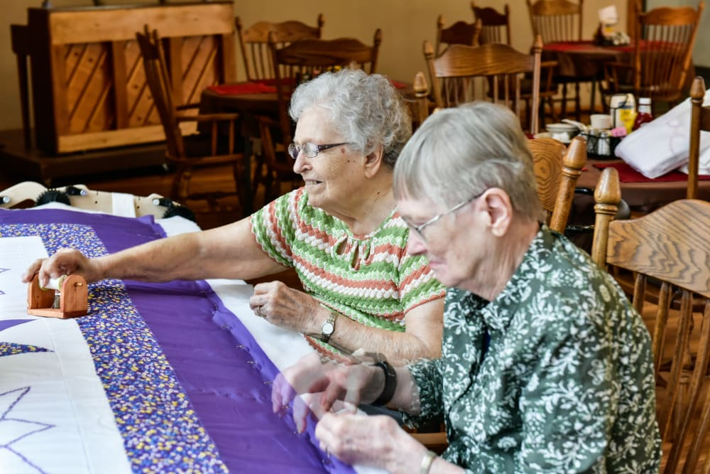 Residents making a quilt at Garden Place Red Bud in Red Bud, Illinois.