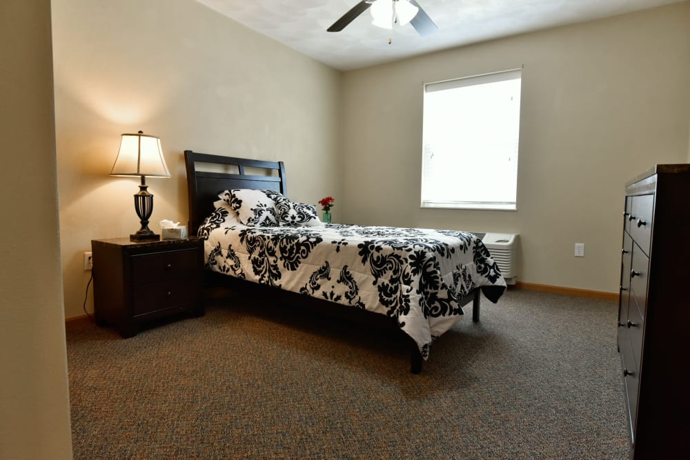 Resident bedroom at Garden Place Waterloo in Waterloo, Illinois.
