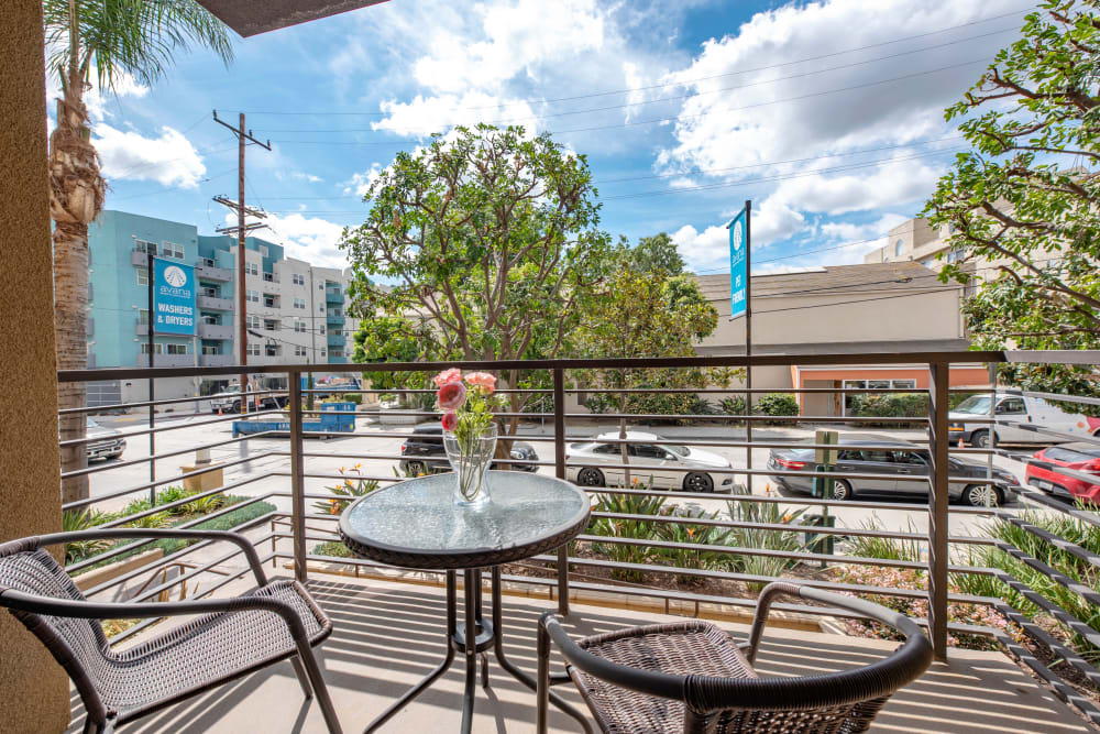 Balcony with table and chairs at Avana North Hollywood Apartments in North Hollywood, CA