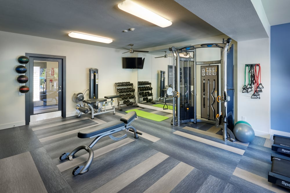 Fitness center with plenty of individual workout stations at Arapahoe Club Apartments in Denver, Colorado