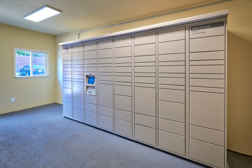 The convenient package room at The Crossings at Bear Creek Apartments in Lakewood, Colorado