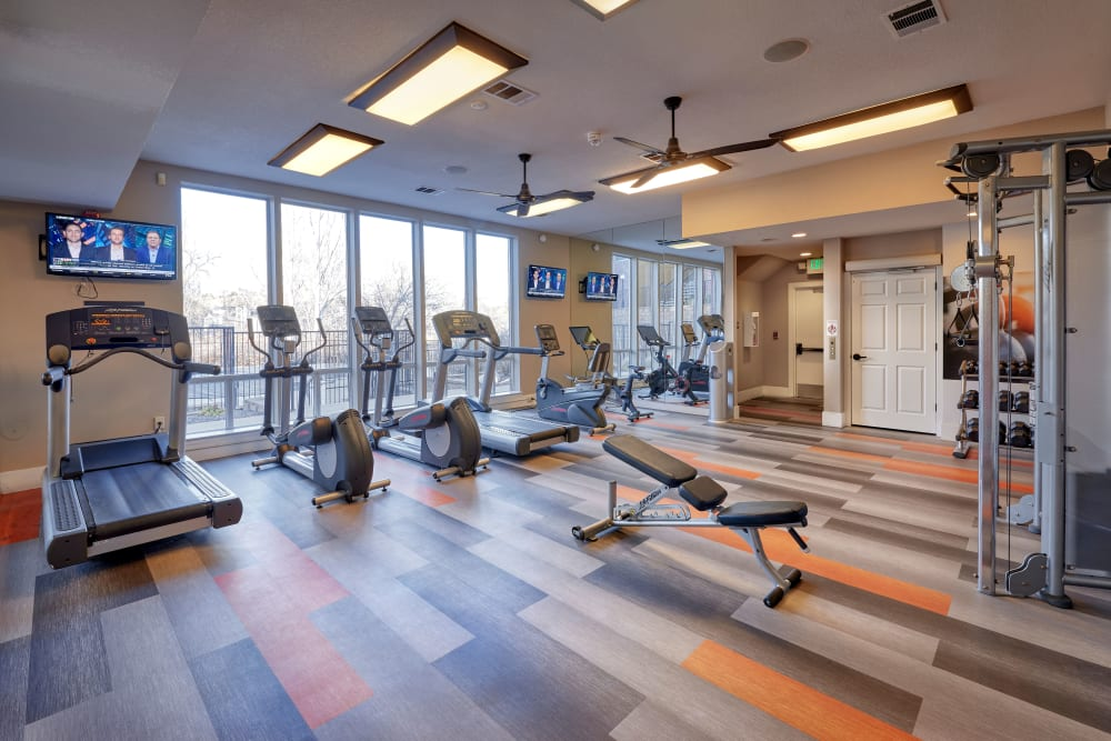 Fitness center with plenty of individual workout stations at The Crossings at Bear Creek Apartments in Lakewood, Colorado