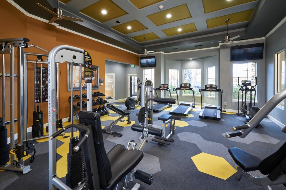 Fitness center with plenty of individual workout stations at Legend Oaks Apartments in Aurora, Colorado