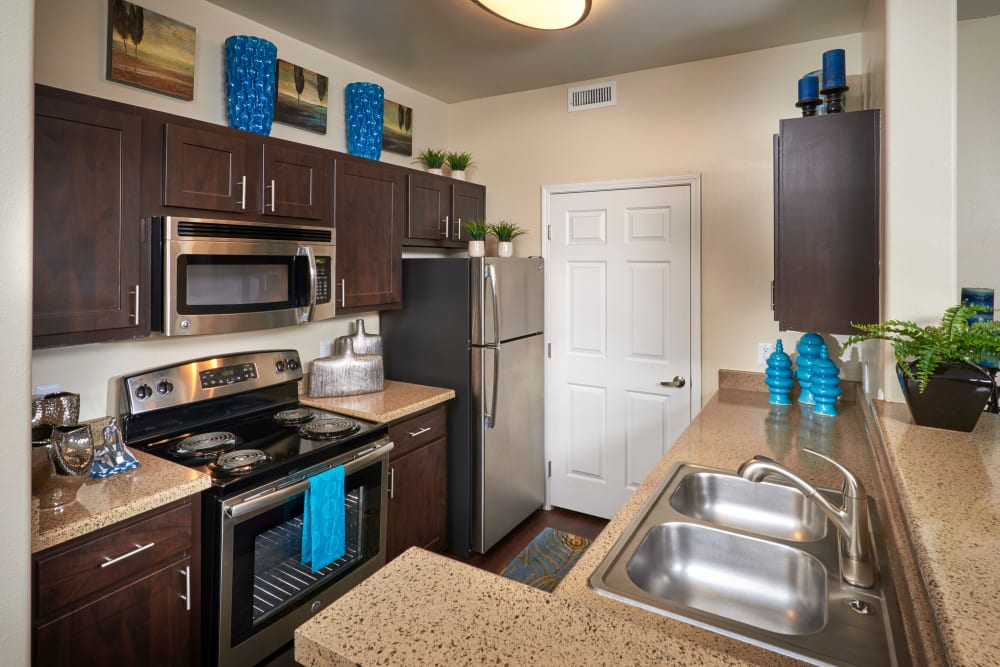 A kitchen with plenty of cabinet space at Promenade at Hunter's Glen Apartments in Thornton, Colorado