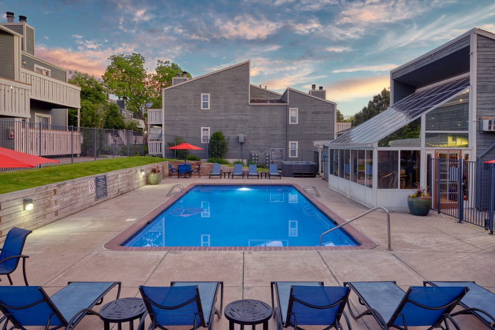 Beautiful resort-style swimming pool at sunset at Bluesky Landing Apartments in Lakewood, Colorado