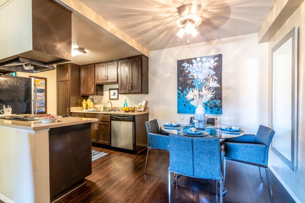 Dining room with wood-style flooring at Terra Nova Villas in Chula Vista, California