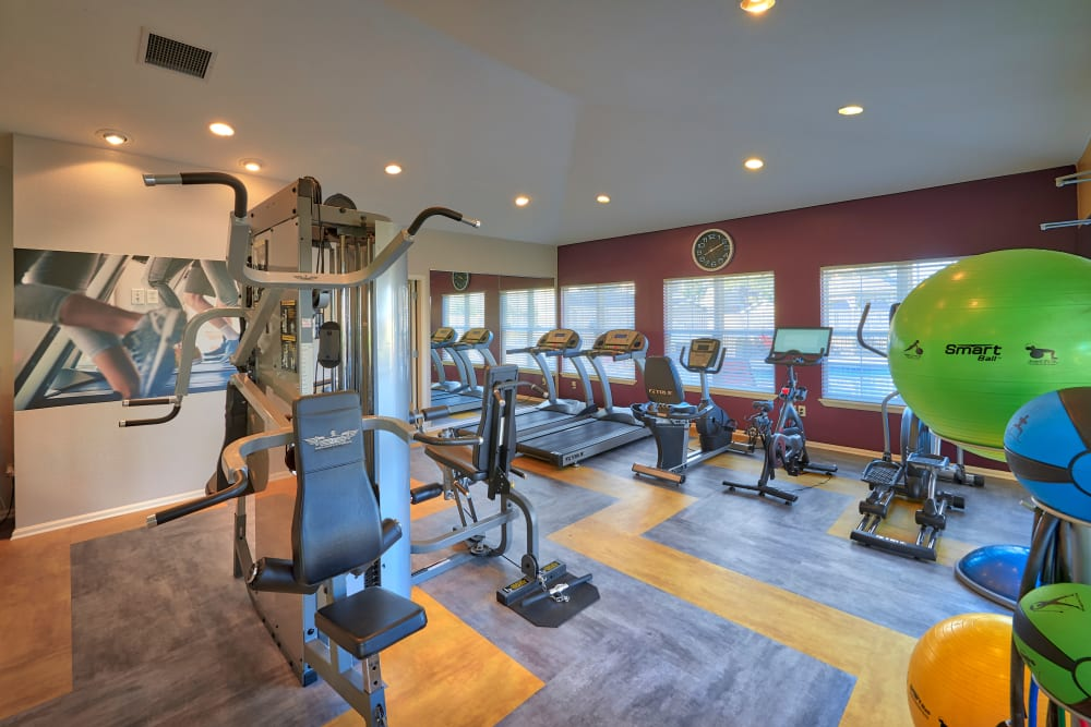 Fitness center with plenty of individual workout stations at Westridge Apartments in Aurora, Colorado