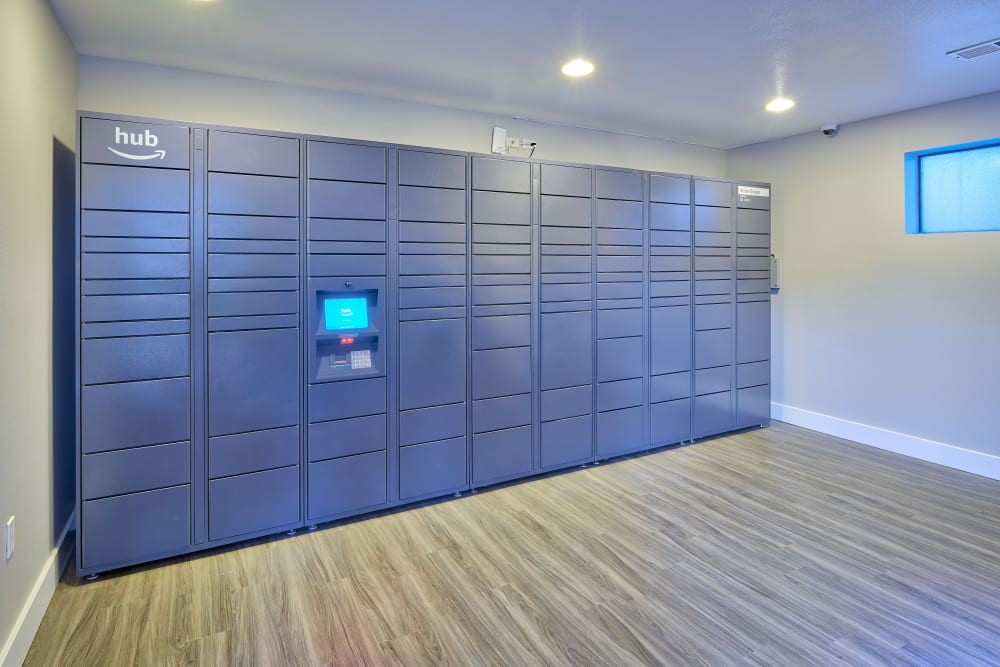 The convenient package room at Alton Green Apartments in Denver, Colorado