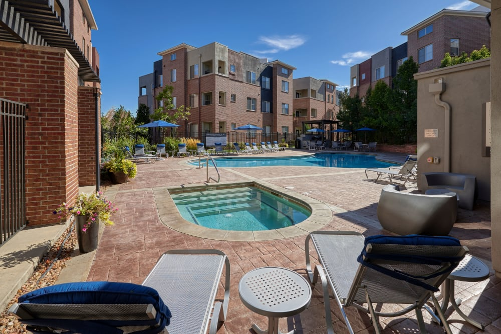 Swimming pool and spa with a sundeck and lounge chairs at The Rail at Inverness in Englewood, Colorado