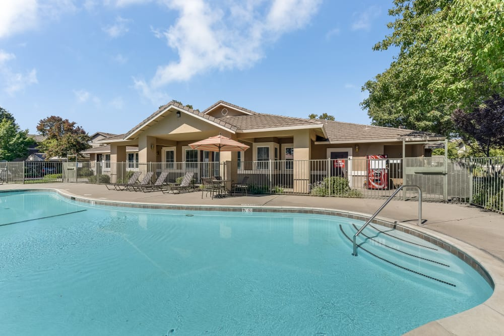 Beautiful resort-style swimming pool at Natomas Park Apartments in Sacramento, California