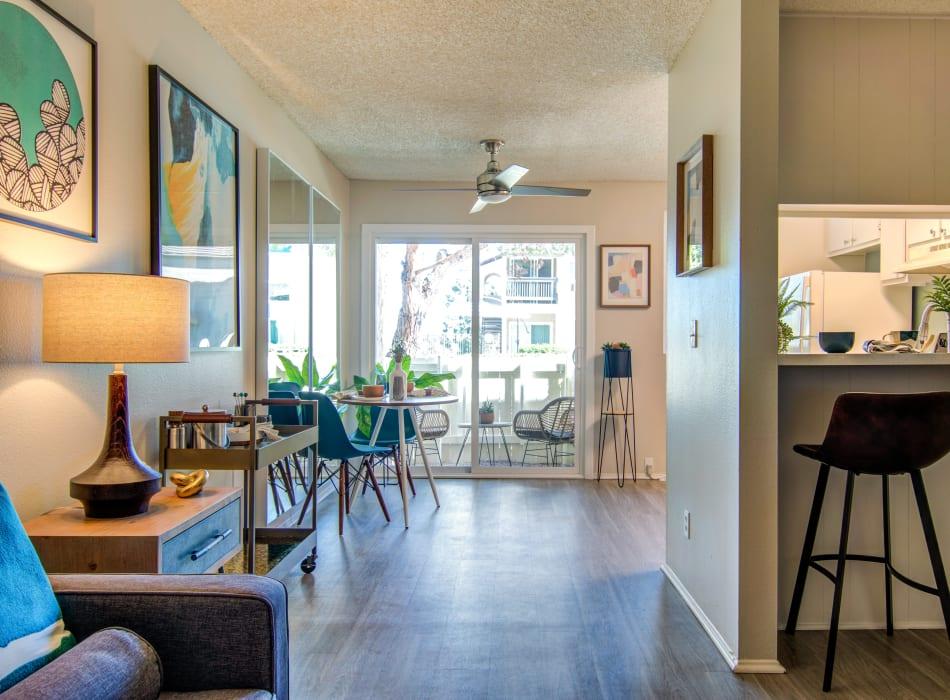 Hallway leading to the private patio from the kitchen's breakfast bar in a model home at Veranda La Mesa in La Mesa, California