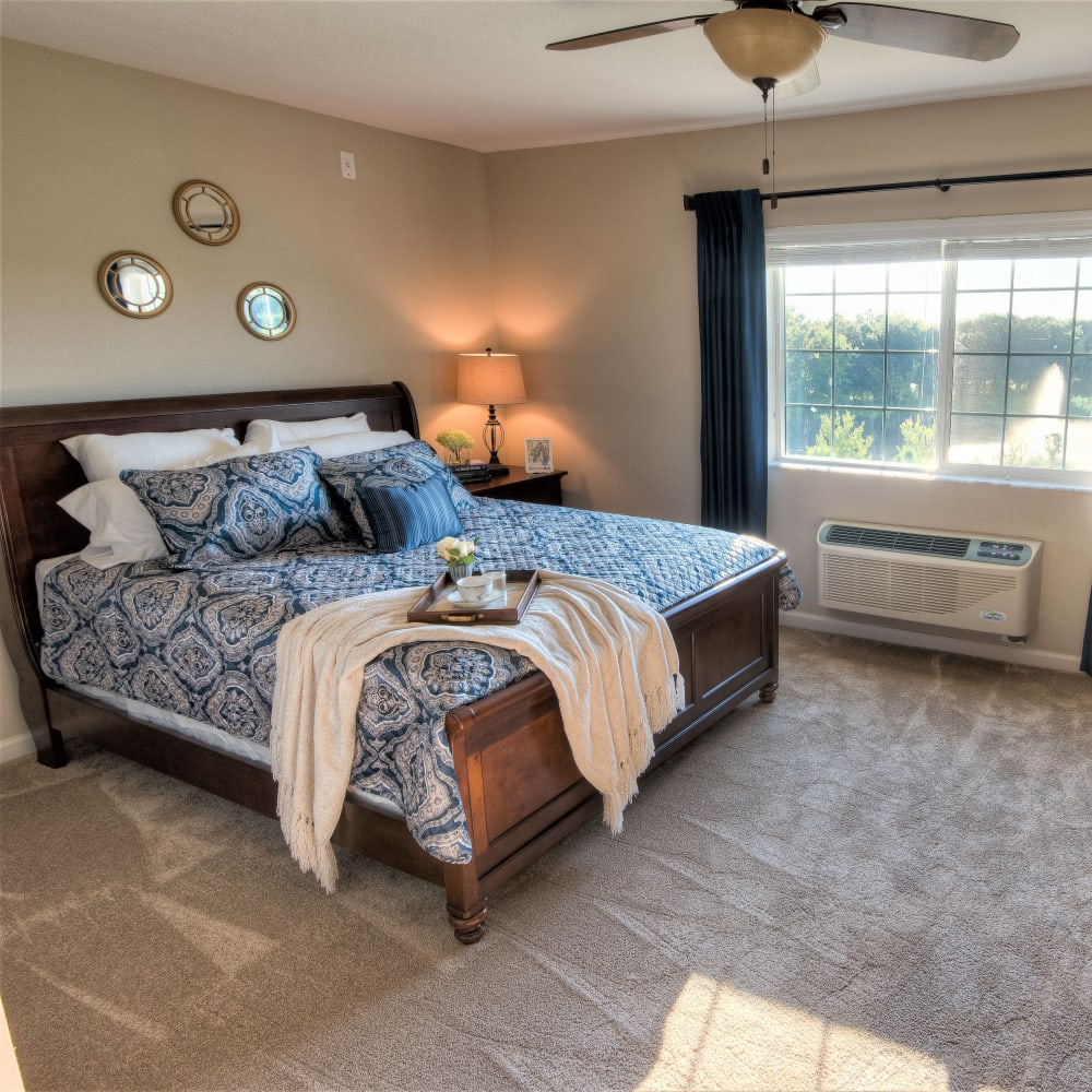 Resident bedroom at Inspired Living Lewisville in Lewisville, Texas.