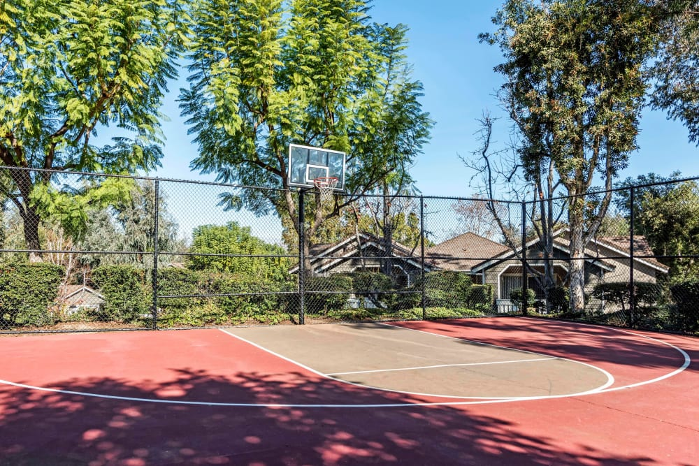 The red basketball court at Village Oaks in Chino Hills, California
