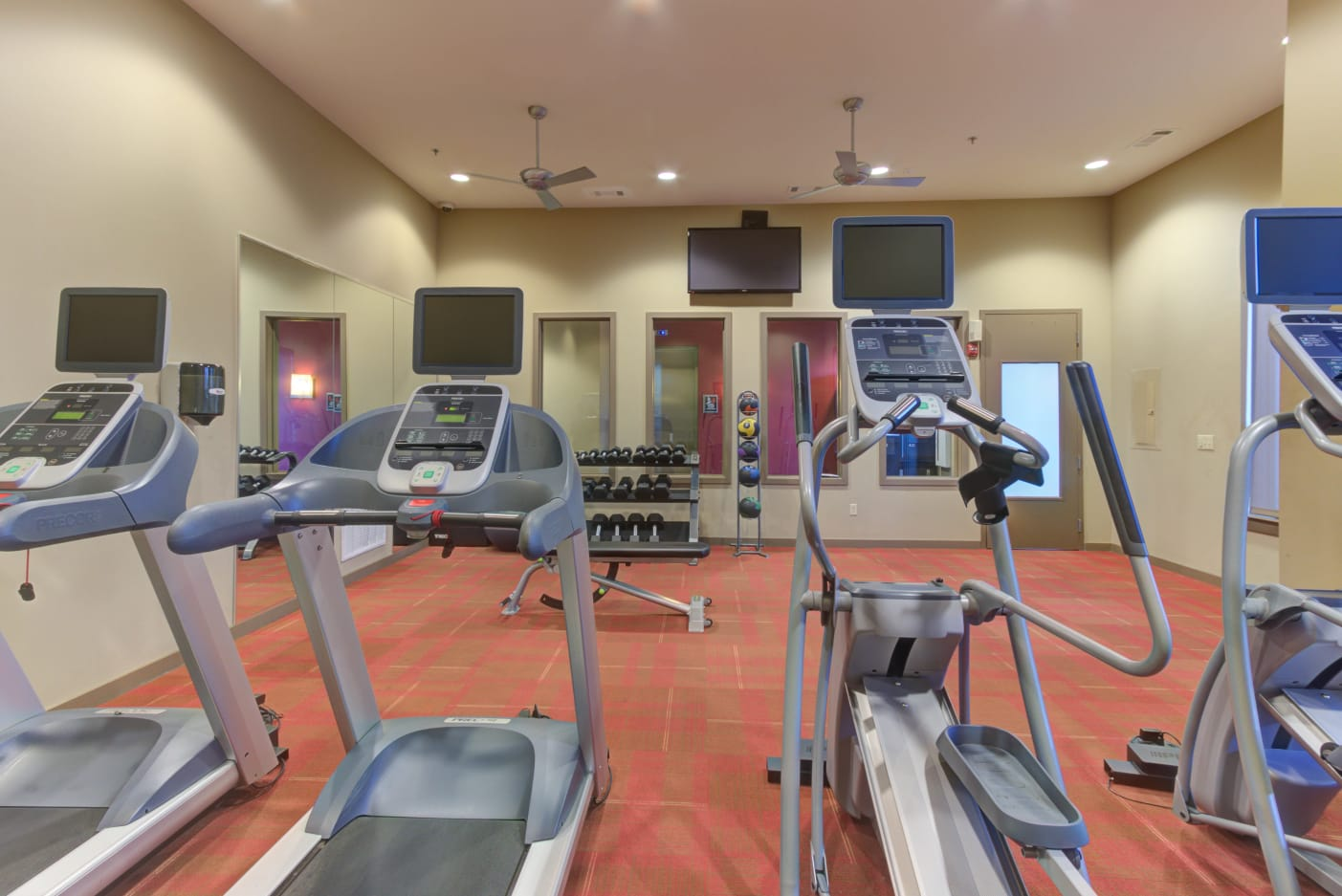Get your cardio on in the fitness center at 12 South Apartments in Nashville, Tennessee