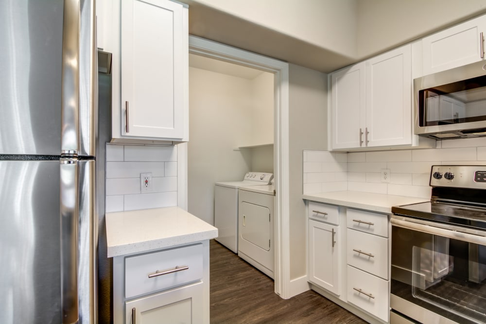 Kitchen and laundry room at apartments in Chandler, Arizona
