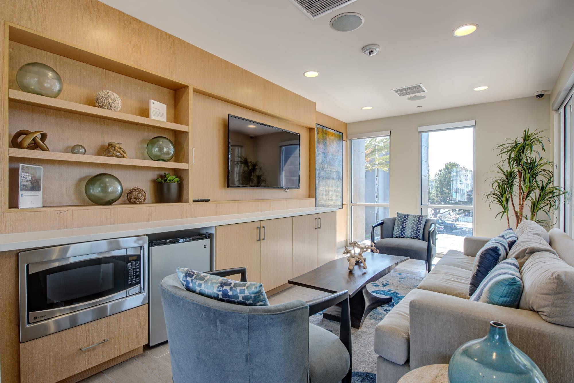 The inviting resident lounge at Harborside Marina Bay Apartments in Marina del Rey, California