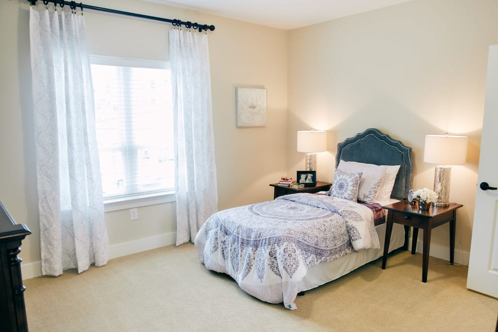 A spacious, decorated bedroom at Harmony at West Ashley in Charleston, South Carolina