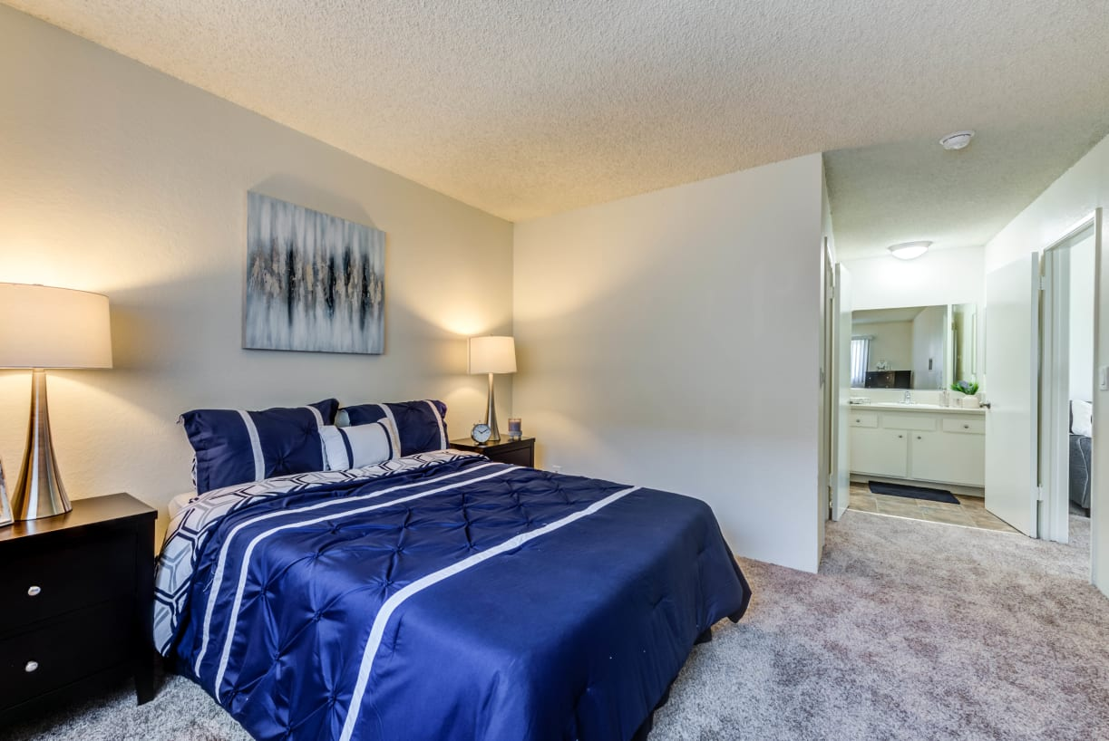 Spacious bedroom with ensuite bath at The Newporter in Tarzana, California