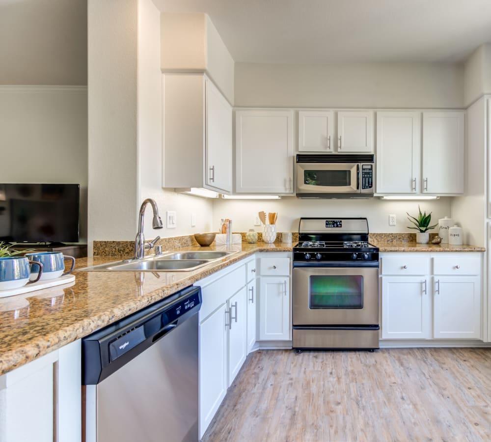 Open, spacious kitchen in a model home at Sofi Shadowridge in Vista, California