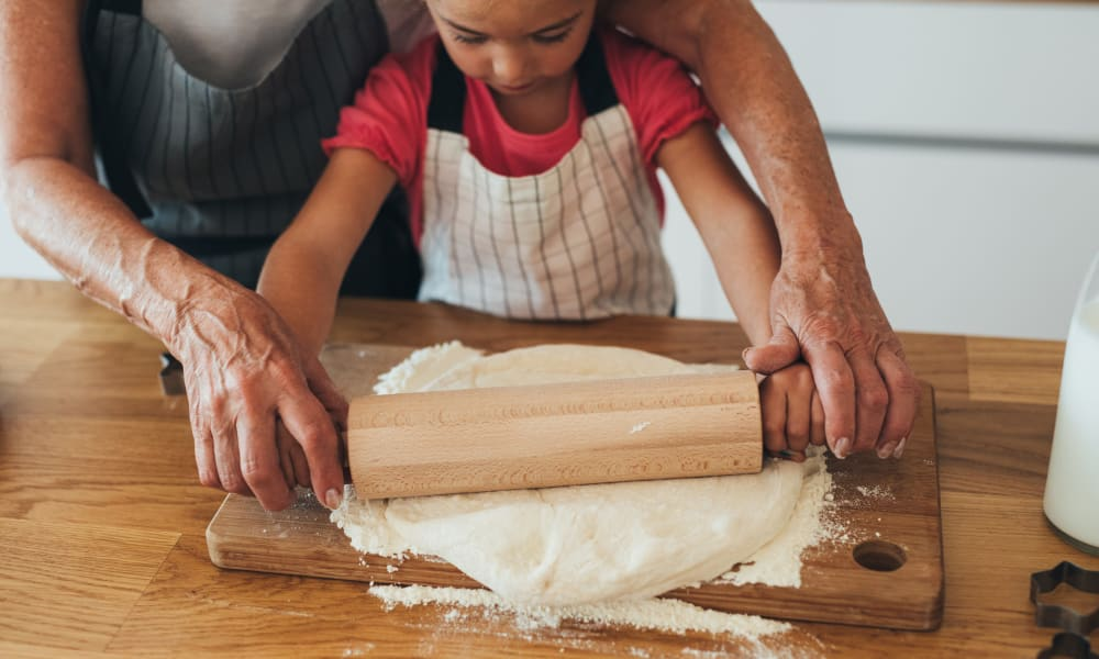 Teaching a kiddo to roll dough at Abrams Hall Senior Apartments in Washington, District of Columbia
