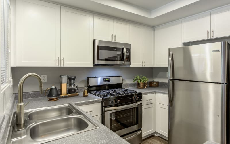 Renovated kitchen with white cabinets at Village Oaks in Chino Hills, California