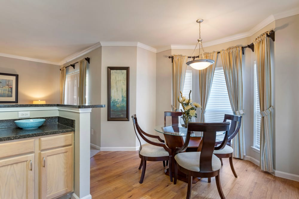 Elegantly decorated dining area in an apartment home with nine foot ceilings and crown molding at Regency at First Colony in Sugar Land, Texas