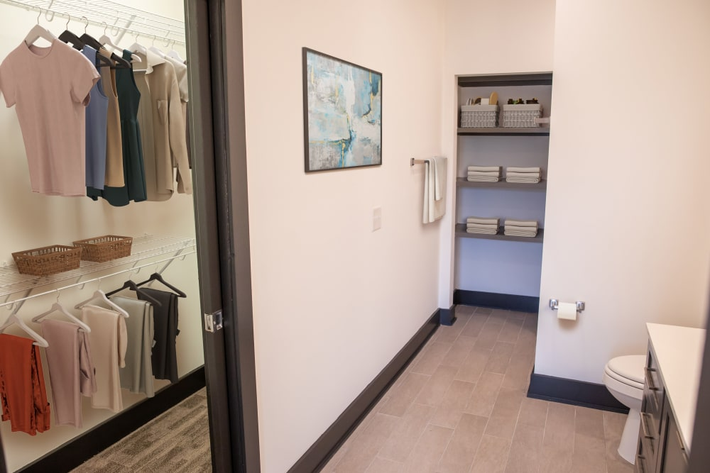 Model bathroom with walk-in closet at Belcourt Park in Nashville, Tennessee