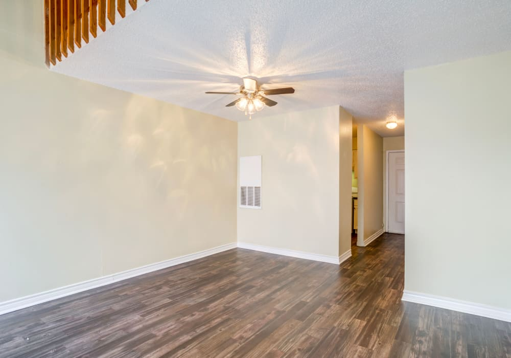 Naturally well-lit living room at Riverstone Apartments, TX