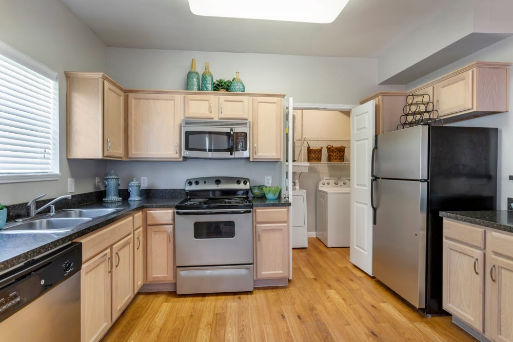 Spacious kitchen and a laundry room with washer and dryer at Regency at First Colony in Sugar Land, Texas