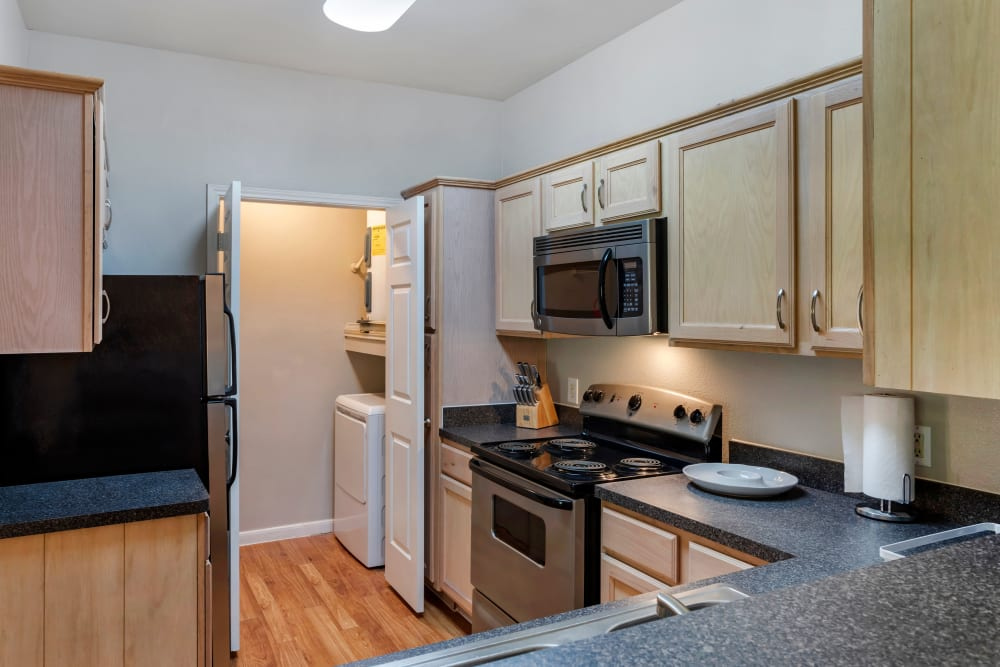 Model kitchen with space saver built-in microwave at Regency at First Colony in Sugar Land, Texas