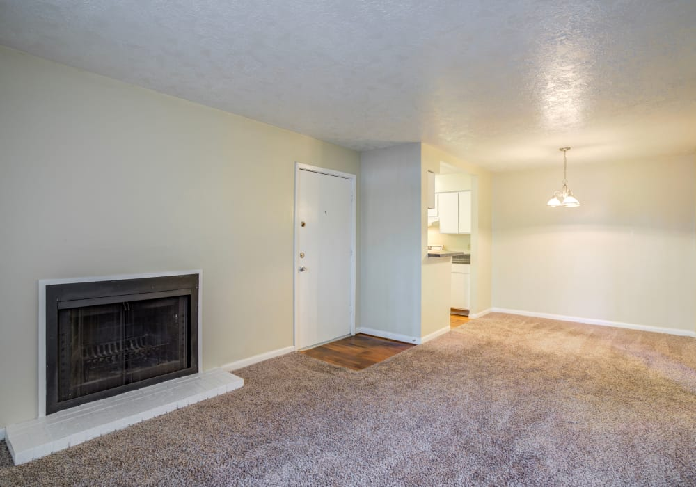 Living room with a fireplace at Riverstone Apartments, TX