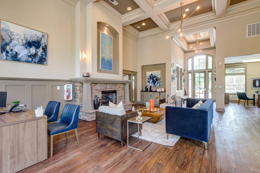 Community space with couches and chairs at Preserve at Steele Creek in Charlotte, North Carolina