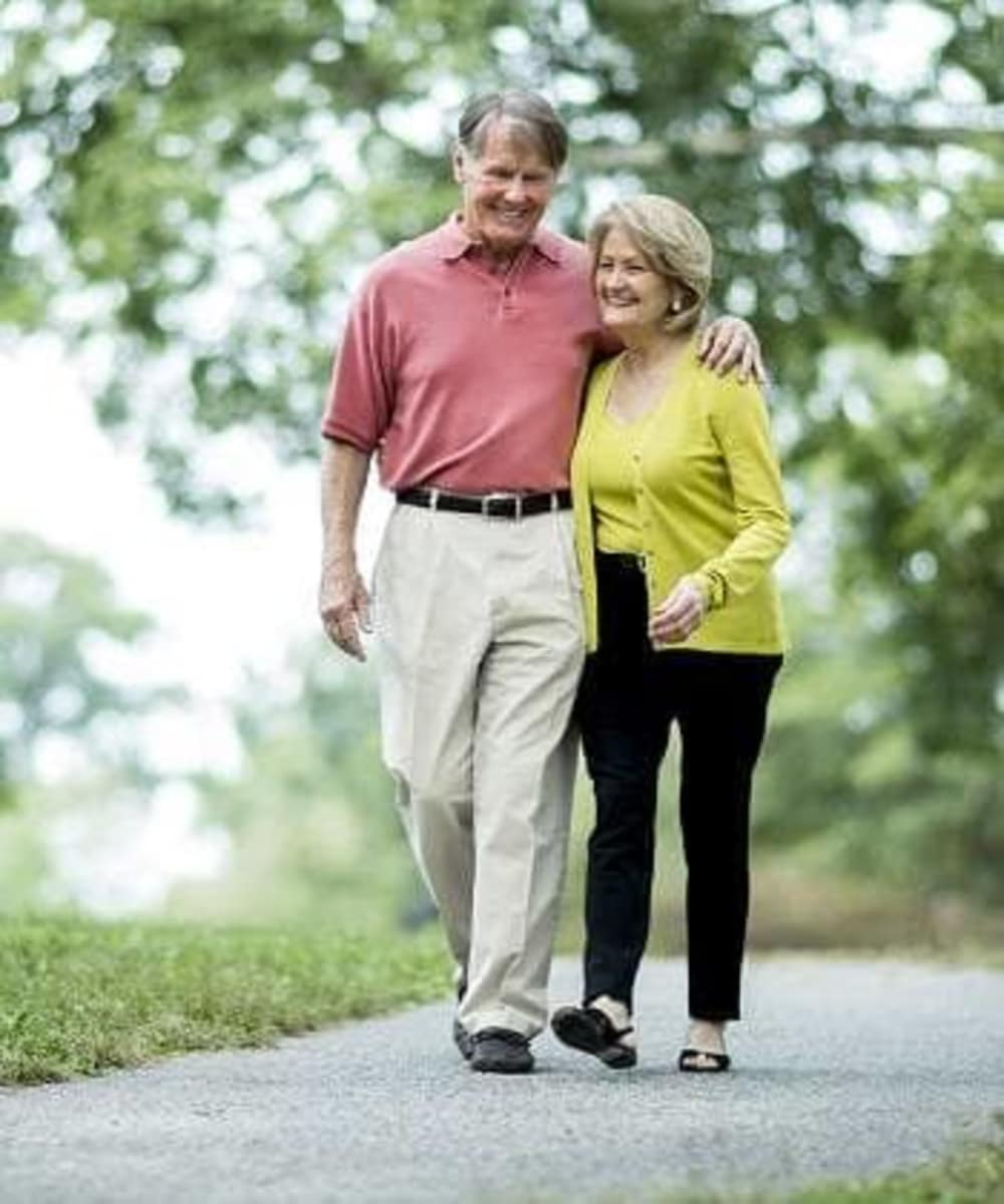 Happy couple walking through Oxford Villa Active Senior Apartments